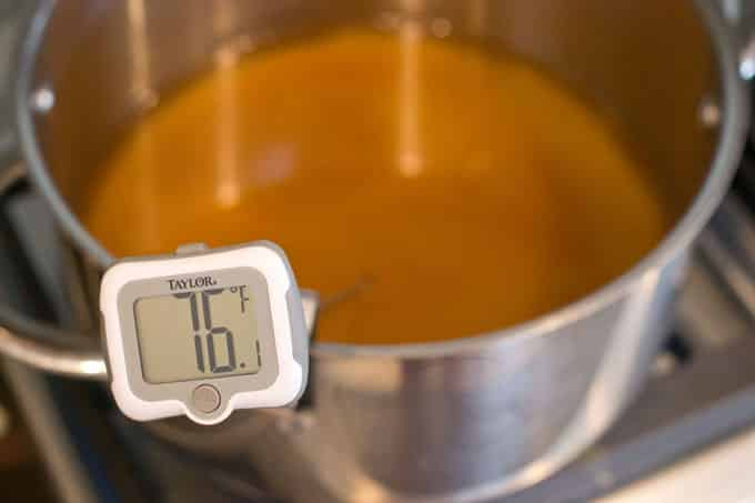 Attach the candy thermometer to the pot.