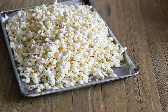 While it's coming up to temperature, put your popcorn on a big pan.