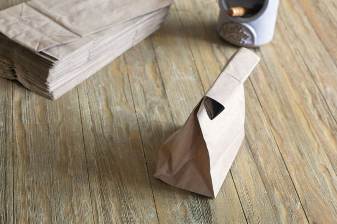 Make a 3/4-inch fold at the top of the bag and then fold it over 5-7 times.