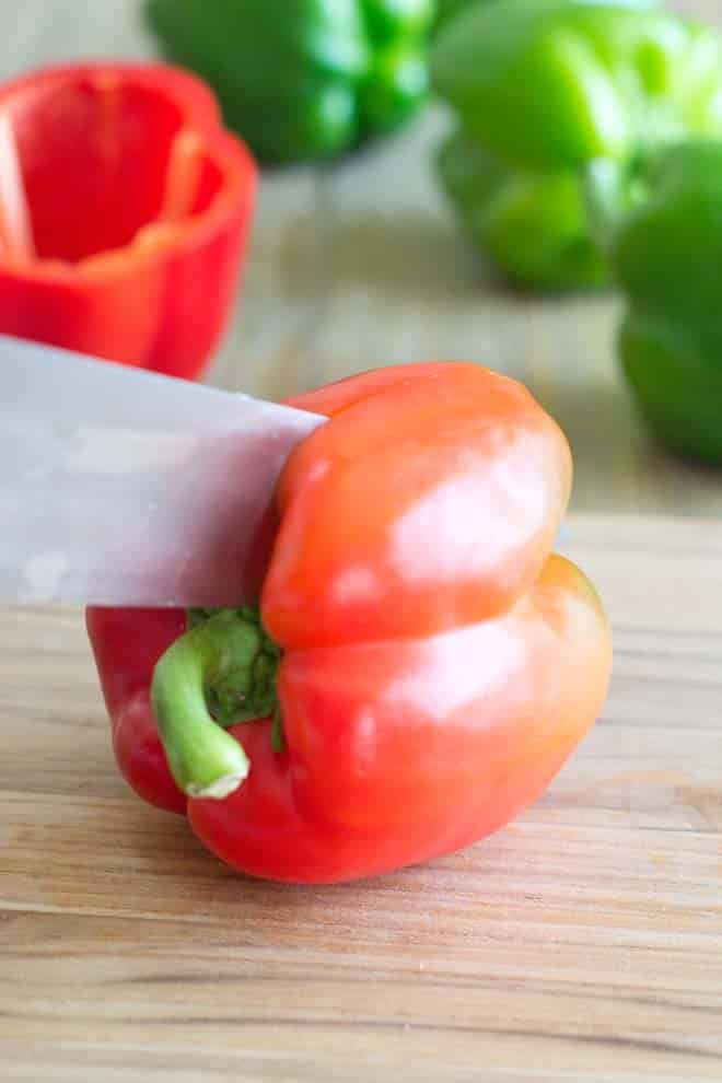 Cutting a Bell Pepper in half for stuffing