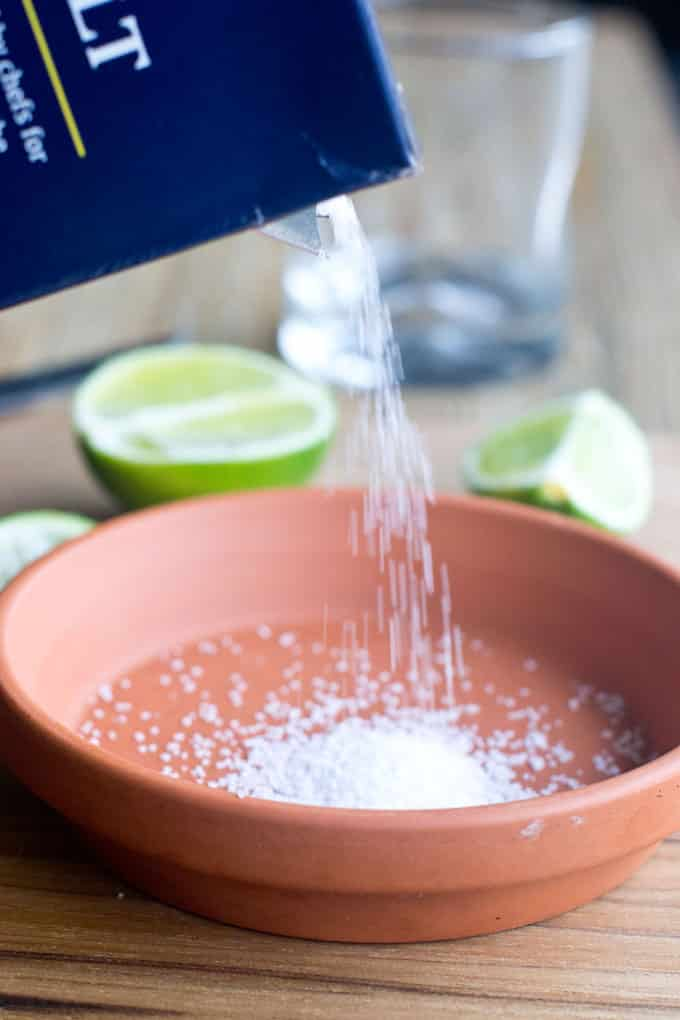Put some salt in a dish that is bigger than the diameter of your glass. What kind of salt? Here we've used kosher