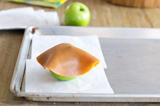 A caramel disc on an apple
