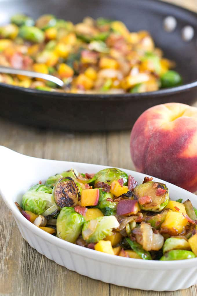 Brussels Sprouts with Peaches and Bacon: Convert all Brussels-sprouts-phobic people in the world by adding some sweet and fatty sass to Brussels sprouts.