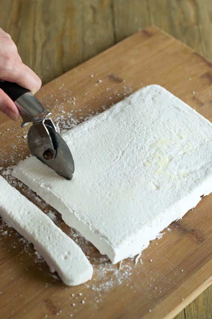 Cut strips of marshmallow with pizza cutter.