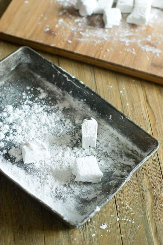 Toss large marshmallows with cornstarch.