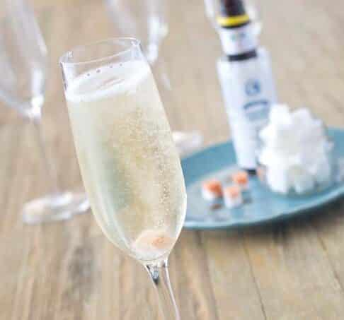 Learn how to make the best cocktail for a celebration, The Classic Champagne Cocktail. It only uses three ingredients and yet is so festive and delicious.