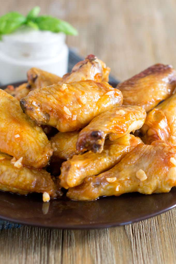 Fancier Buffalo Wings, the wing sauce is made with hot sauce, olive oil, lemon juice and garlic.