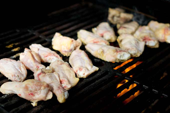 Raw chicken on grill