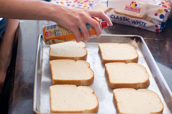 Spray bread with butter cooking spray.