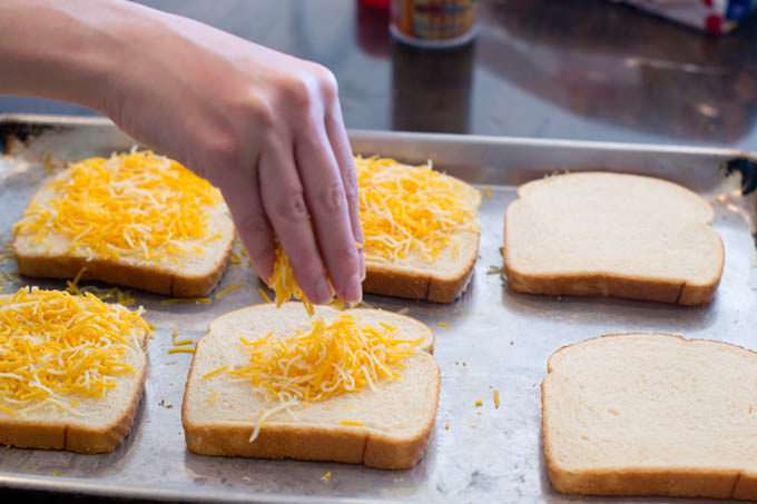 Cover bread with shredded cheese.