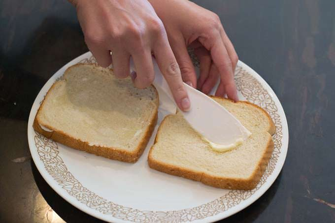 butter the bread on one side