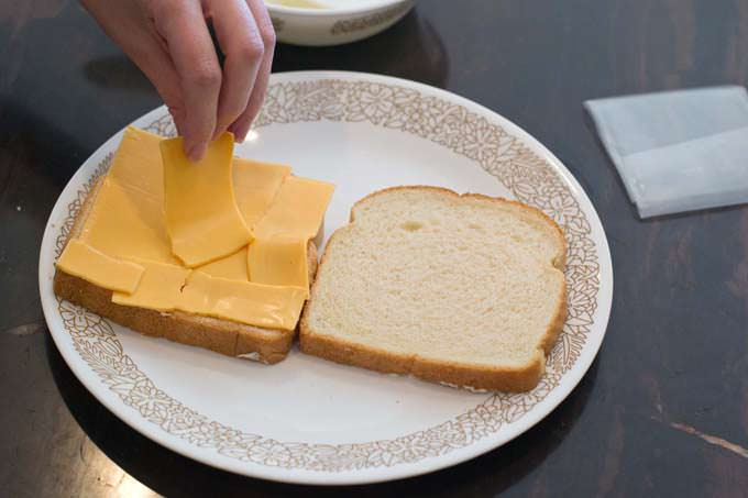 put 2 cheese slices on one slice of bread