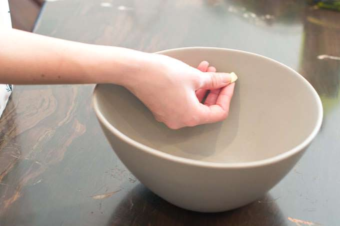 Rub garlic all around the bowl