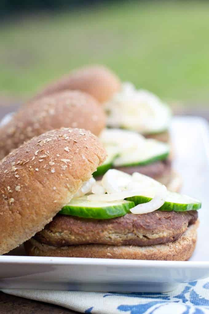 These homemade tofu burgers are spiced up with fun and tasty quick sriracha pickles.
