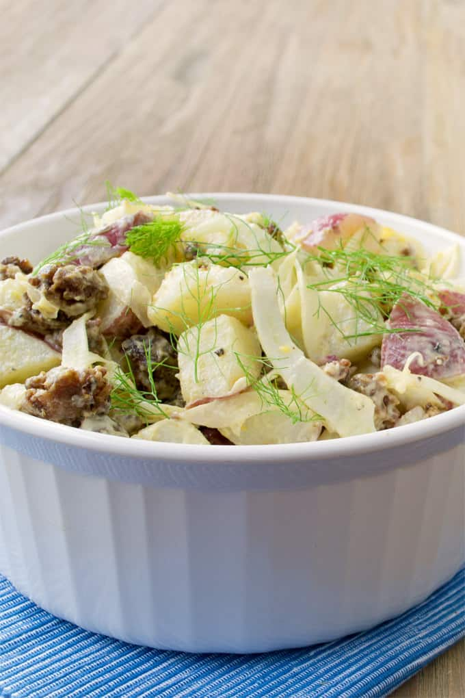 Spruce up potato salad with a some sweet sausage, fennel and sweeeeet Vidalia onion.