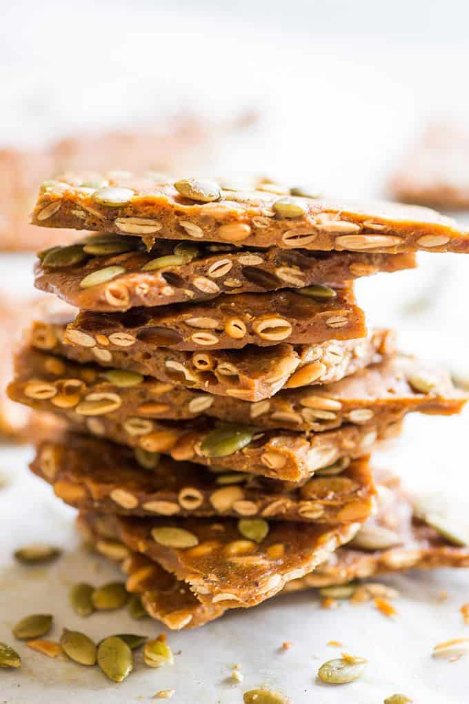 Pumpkin Seed Brittle pieces in a stack.