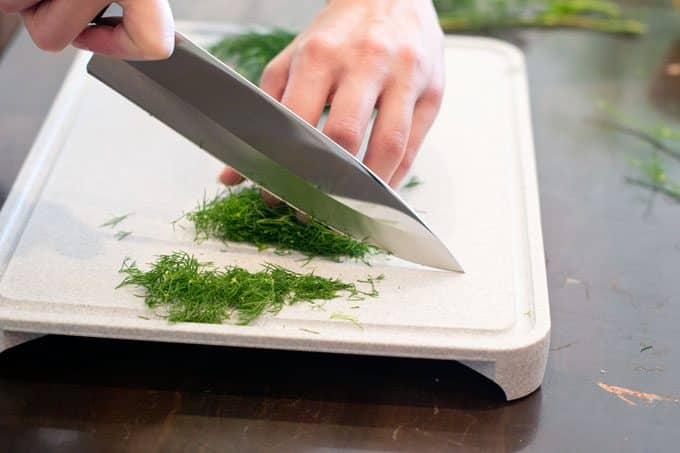 Chopping dill with a knife