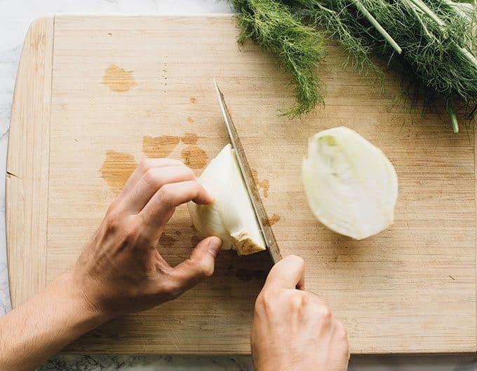 Cut fennel in half