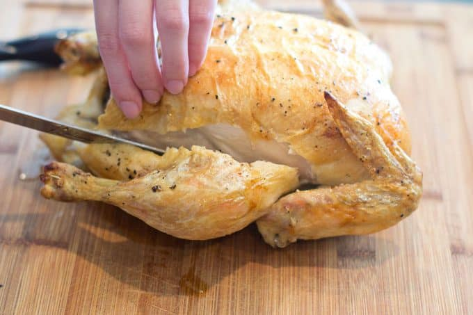 Cutting a chicken thigh