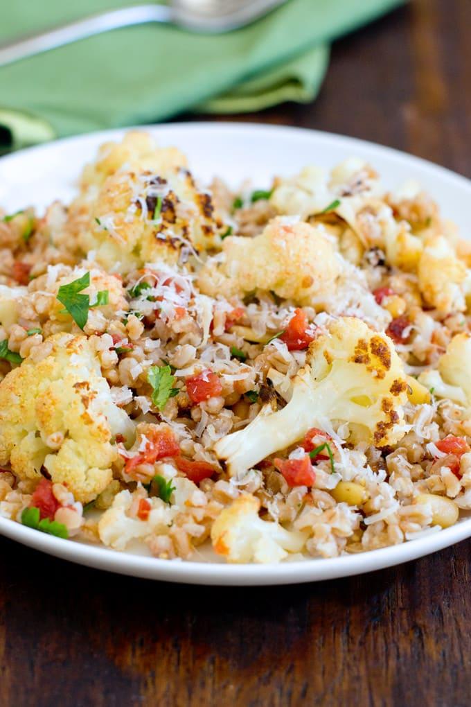 This farro salad has Italian flavors and mellow roasted cauliflower. Soooo good!