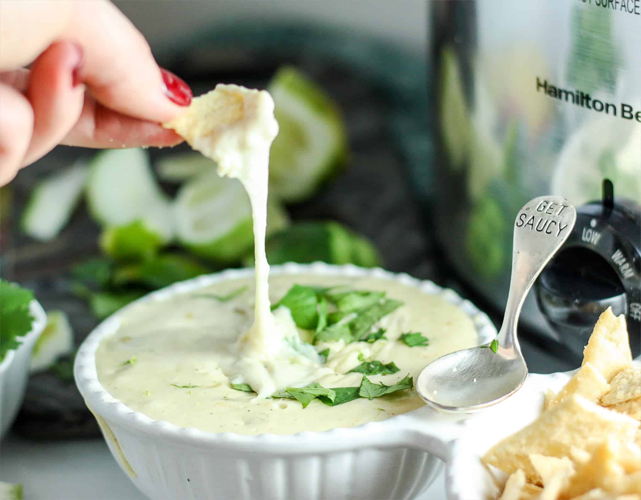 Throw this easy White Slow Cooker Queso together in 5 minutes flat! Yeah, you're totally going to be the life of the party.