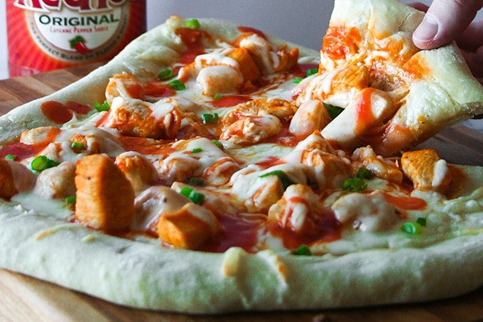 Pizza or wings? Decisions, decisions. Don't pick one. Make pizza with buffalo chicken. Dilemma solved!