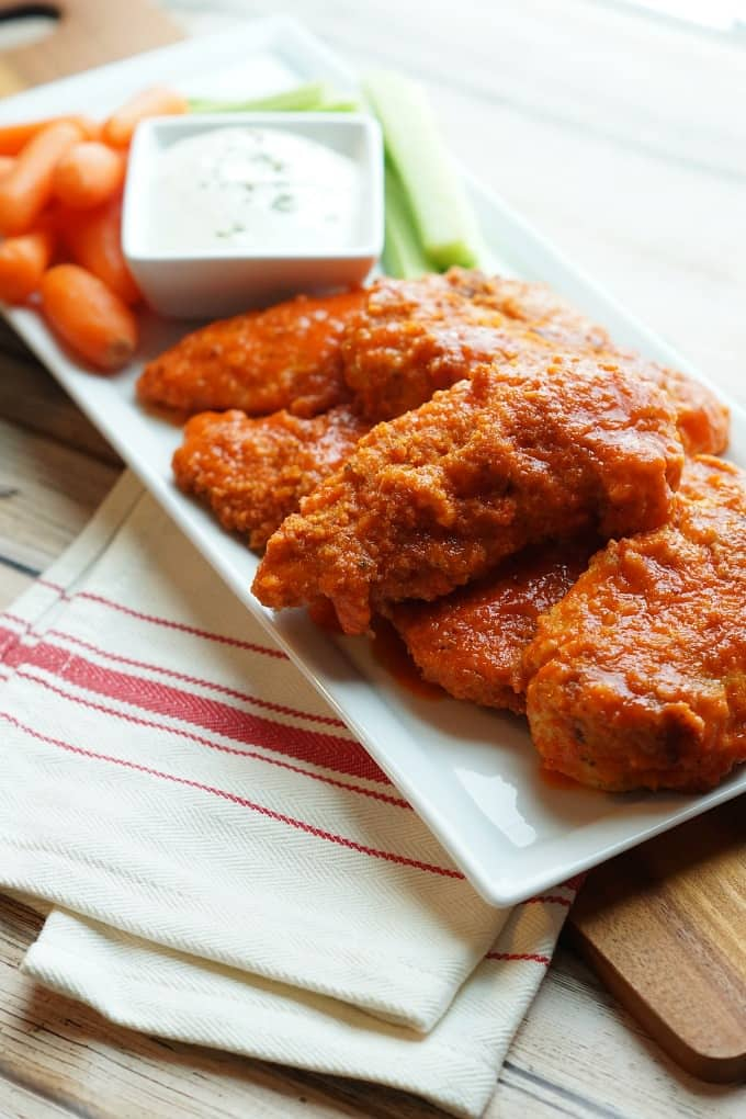 Buffalo Chicken Tenders are a classic, but this recipe is for the ultimate baked buffalo chicken tender, with a secret ingredient. You're going to fall in love with these!