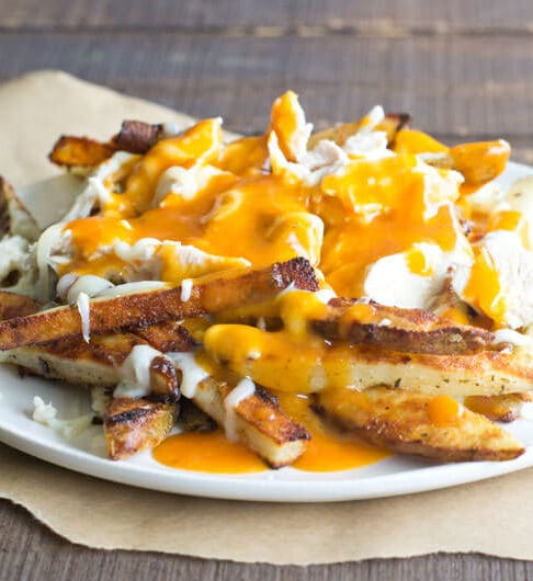 When Buffalo chicken and poutine meet up, you're in for a rich and creamy, spicy, cheesy plate of amazingness. For sure!