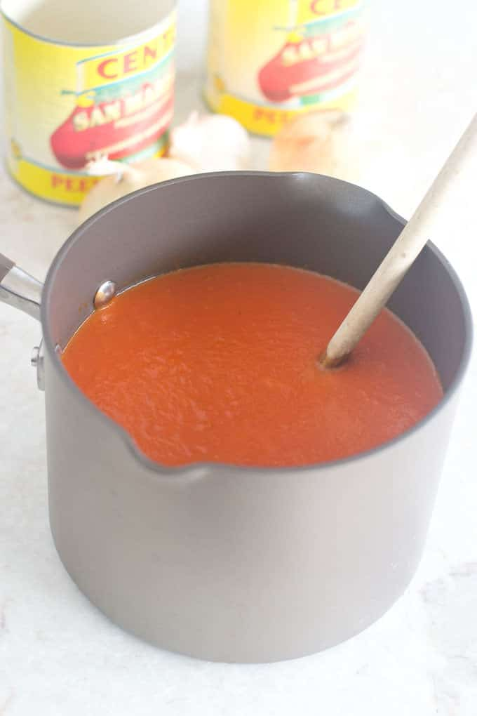 Homemade tomato sauce tastes so much better than from a jar, and it's super easy to make.