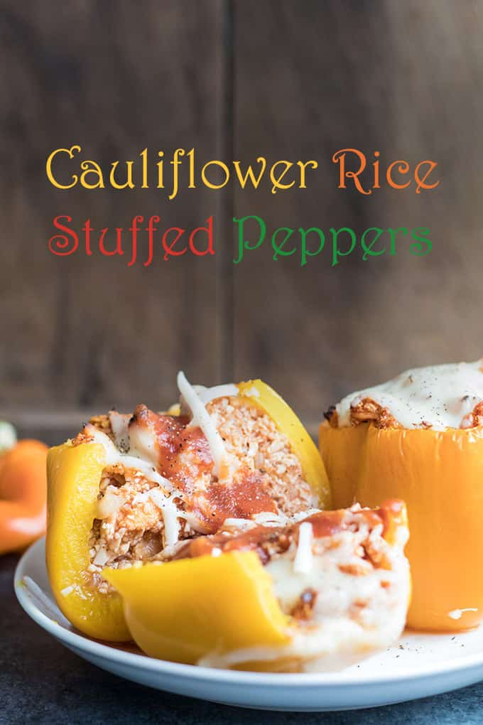 These stuffed peppers are so good, and don\'t contain a lick of rice. Only cauliflower rice here!