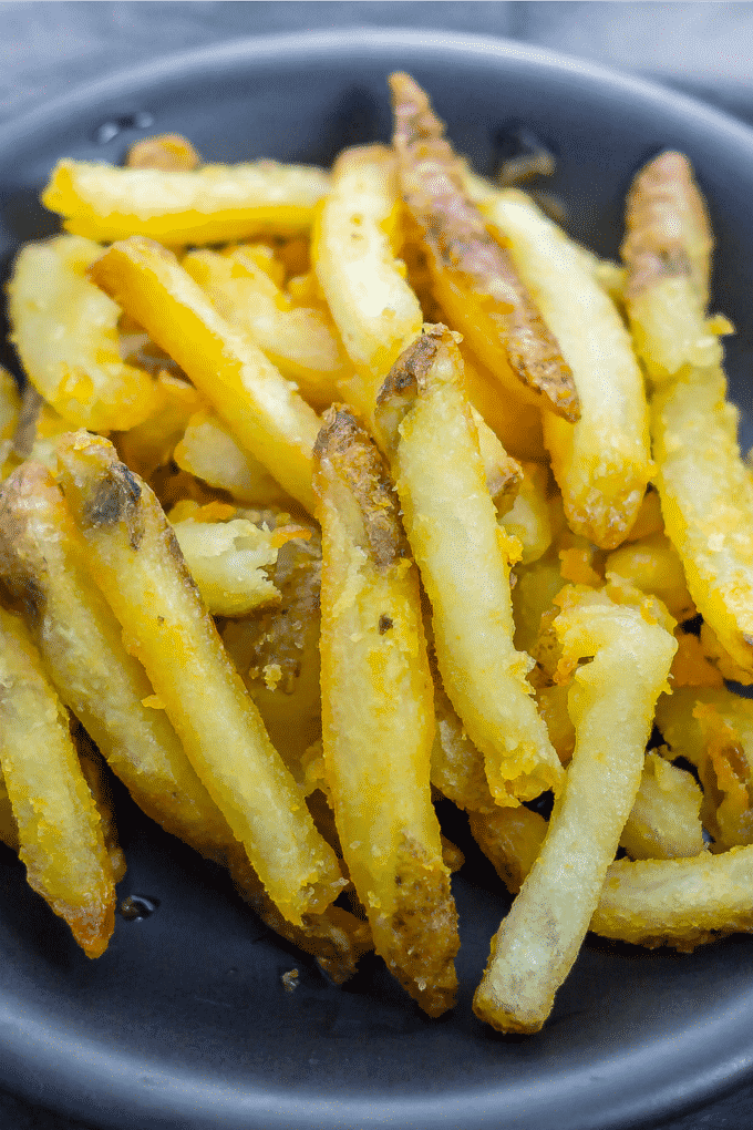 Skip the drive-thru and make homemade deep-fried French fries at home.