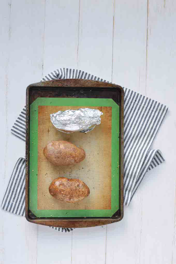 Knowing how to bake a potato to perfection makes weeknight meals so much easier. Throw \'em in while you prep a salad and protein. Dinner\'s done.