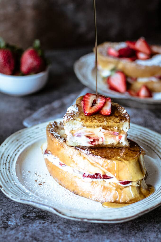 Filled with fresh strawberries and the most delicious vanilla bean cream cheese filling, your family will request Strawberry Stuffed French Toast for brunch every weekend.