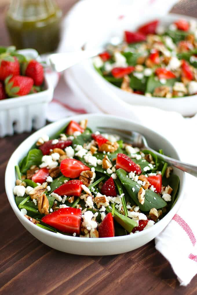 Nothing says summer like a Strawberry Spinach Salad with a drizzle of homemade Poppy Seed Dressing. It's going to be a new family favorite.