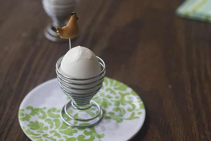 Egg in egg cup, with cracked shell across the top.