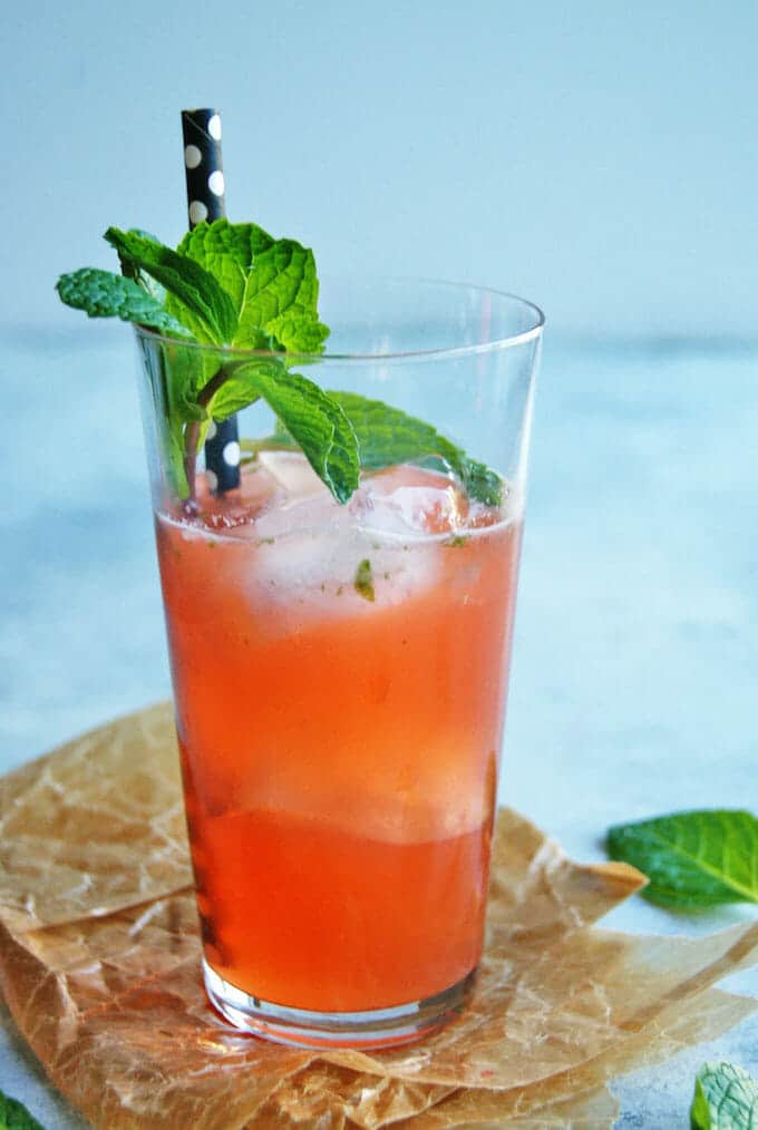 Ahhhhh, mojitos. What's not to love? Lime, mint, a bit of sparkle? We're kicking it up with Strawberries Mojitos.