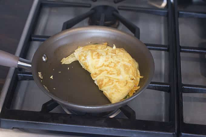 Egg folded over omelet filling.