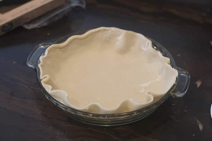 Pie crust in a pie dish.