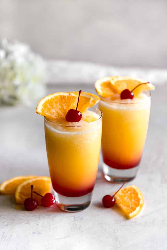 You won't believe how easy it is to make a Tequila Sunrise, and all you need is a few ingredients. (And yes, that layered look is easy too!)