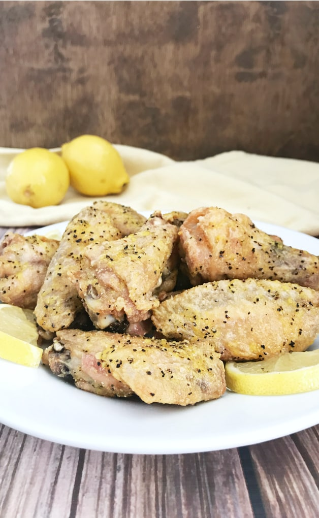 These Lemon Pepper Chicken Wings aren\'t coated in sauce but you\'ll have to try not to lick the plate when you taste this homemade lemon pepper seasoning.