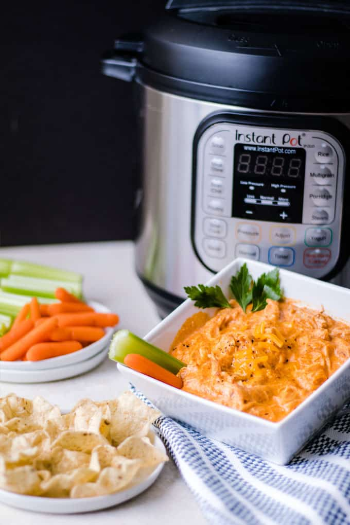 Meet your new favorite way to enjoy Buffalo Chicken Dip! This party favorite is easier than ever and the pressure cooker locks in all the delicious flavor so much faster.