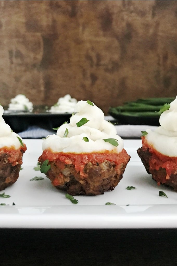 Meatloaf Cupcakes are a fun way to serve meatloaf and mashed potatoes and make the perfect party dish too. Kids and adults alike are bound to love them.