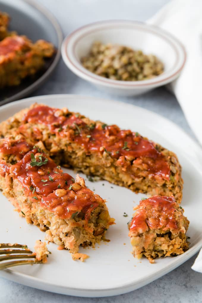 This Easy Vegan Meatloaf is made with a base of chickpeas and lentils and is a hearty and satisfying meal. It's so simple to make and is a comforting dinner everyone will enjoy.