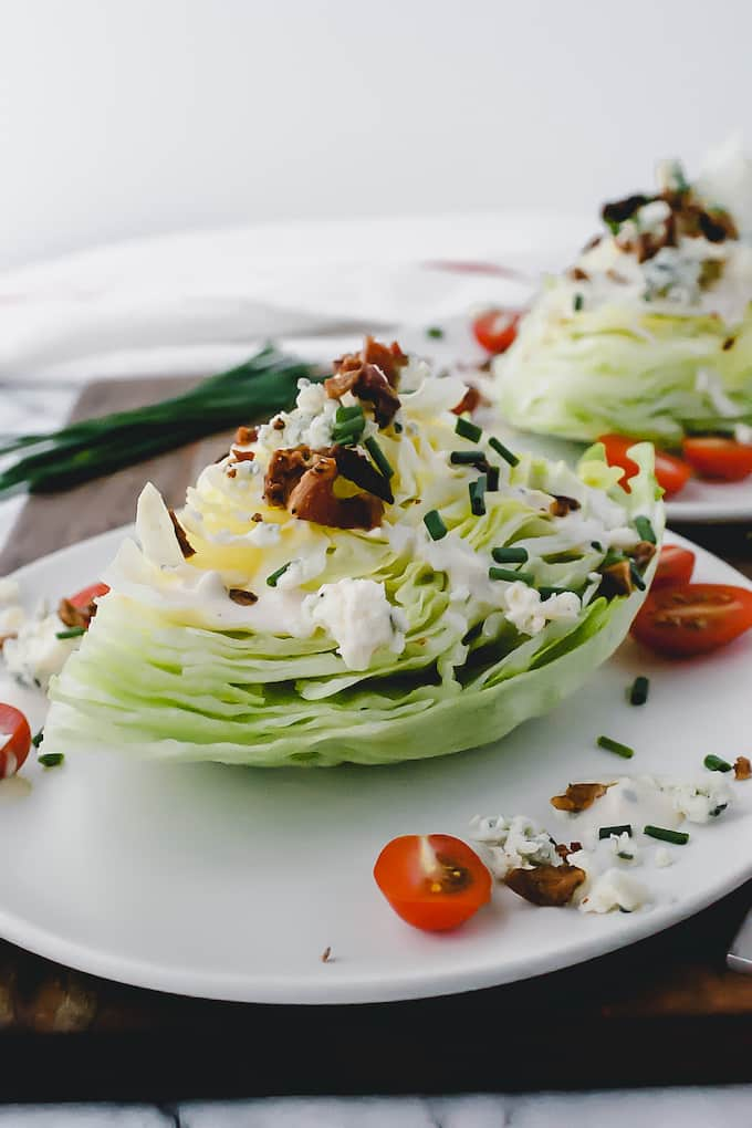 A Classic Wedge Salad never goes out of style but we're making it better. While you could buy blue cheese dressing, we use a homemade version that is so delicious!
