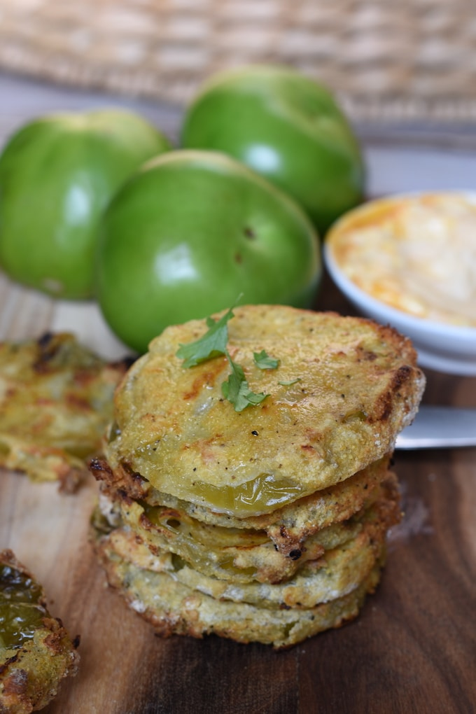 Air Fryer Green Tomatoes have the same satisfying crunch as their fried counterparts without all the grease. What's not to love about that?