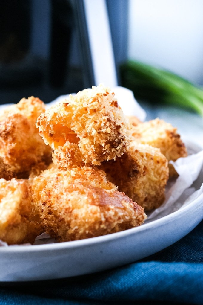 You can make your favorite mac and cheese appetizer at home and cut the grease at the same time. These Air Fryer Mac and Cheese Bites are the way to go.