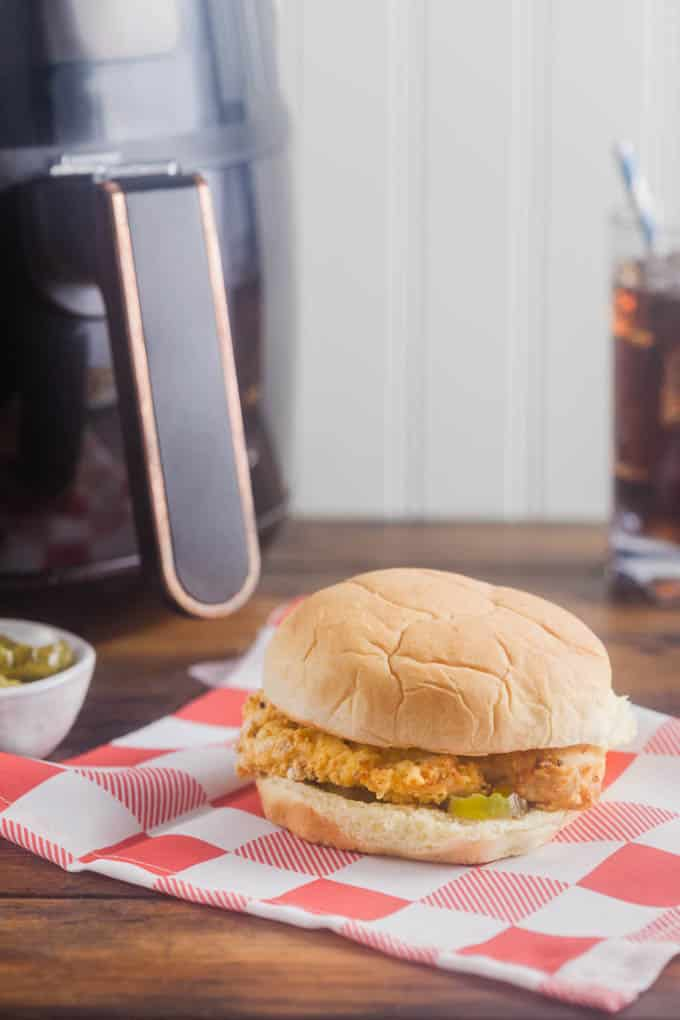 Next time you're craving a crispy chicken sandwich from your favorite fast food joint, look no further than your air fryer! Cooking the chicken in your air fryer gets it super golden and crisp without the mess (or smell) of fry oil.
