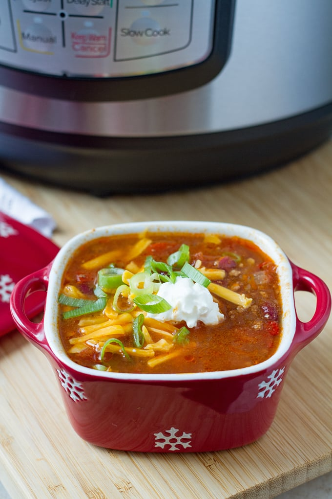 Thanks to the Instant Pot you can have a hearty bowl of chili on the table in no time. And it still tastes like it's been simmering for hours. What a win.