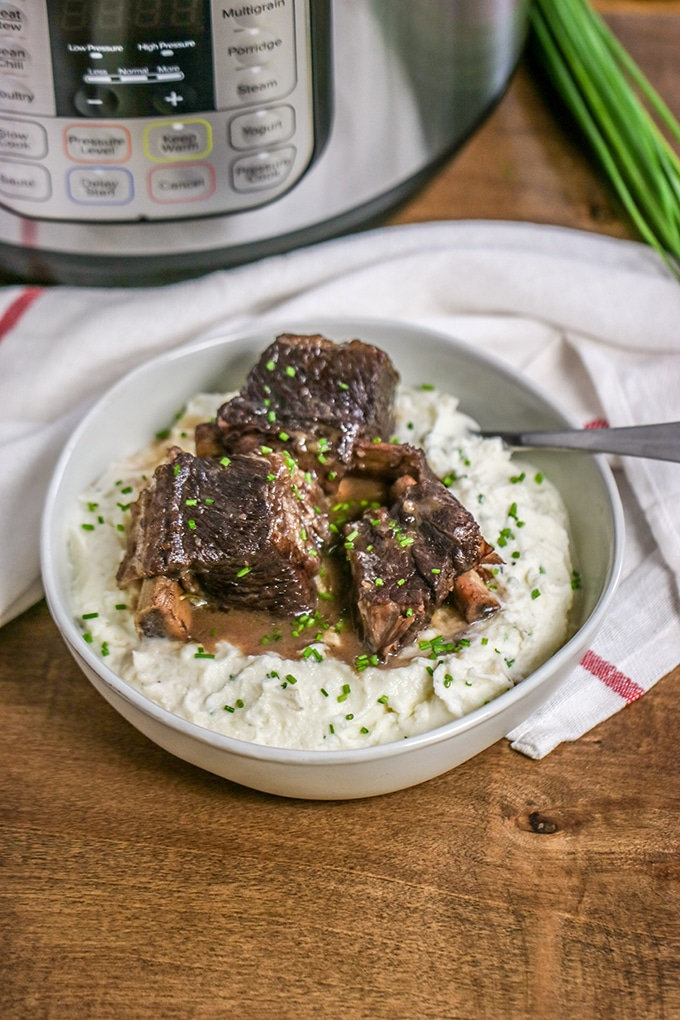 This is a dish that has a reputation for being intimidating to cook. Maybe it's because of the name, or maybe because they take so long to cook. Following these steps for making short ribs in your Instant Pot will help you make short ribs that practically melt-in-your-mouth (and in so much less time).