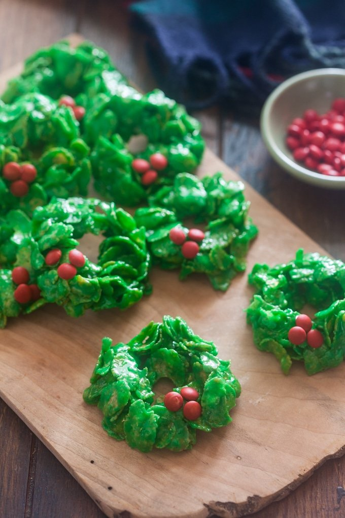It's almost impossible to see a tray of Christmas Wreath Cookies and not smile - whether you're a kid or an adult. There's just something about them that's so festive and nostalgic. It doesn't hurt that they're also absolutely delicious!